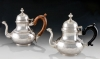 "Two pear-shaped teapots. Left: Marked ""IB"", unidentified; Right: unmarked. New York, or Albany, N.Y., 1740–1760. Silver, wood. The Art Museums of Colonial Williamsburg. Museum Purchase (1964-274 and 1964-275)."