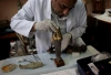 An Egyptian restorer fixes one the pieces that was broken by looters at the Egyptian Museum