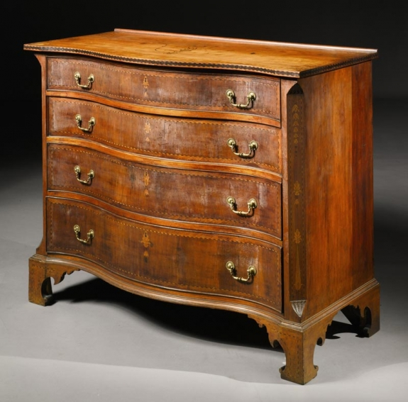 An Important Searls Family Chippendale Highly Inlaid Cherrywood and Mahogany Chest of Drawers, Attributed to Nathan Lombard, Sutton, Massachusetts, circa 1800. Est. $250/700,000; Sold for $872,500. Courtesy Sotheby's New York, Important Americana, 21 & 22 January 2011, lot 337.