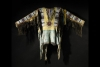 Oglala Sioux Beaded and Fringed Hide War Shirt. Est. $250/250,000. Sold for: $2,658,500.