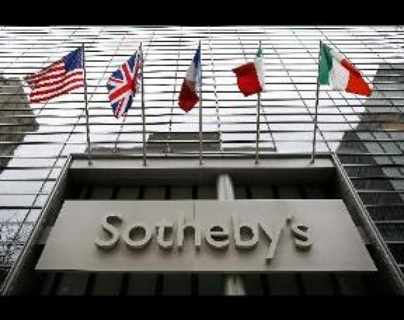 Flags fly outside Sotheby's in New York.