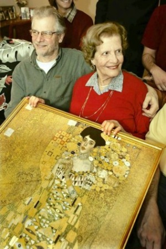 "Maria Altmann, with son Peter, holds a print of ""Portrait of Adele Bloch-Bauer."""
