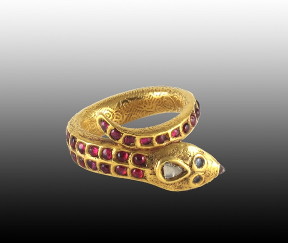 A ruby and gold snake ring, South India, 19th century.
